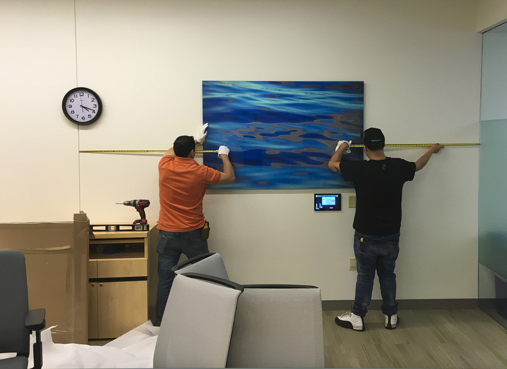 Bolivar and John installing one of 35 large face-mounted photographs by Stephen Gorman in a permanent exhibit at The Dartmouth Institute, Geisel School of Medicine, Dartmouth-Hitchcock Medical Center, Lebanon, New Hampshire (click to enlarge).