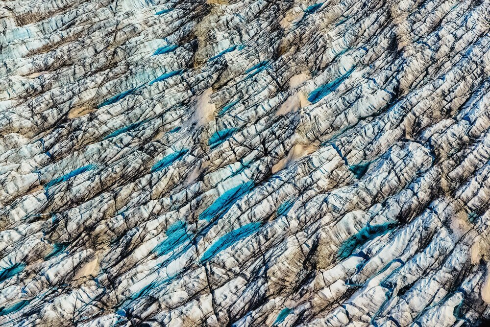 Multi-Colored Crevasses and Supraglacial Lakes