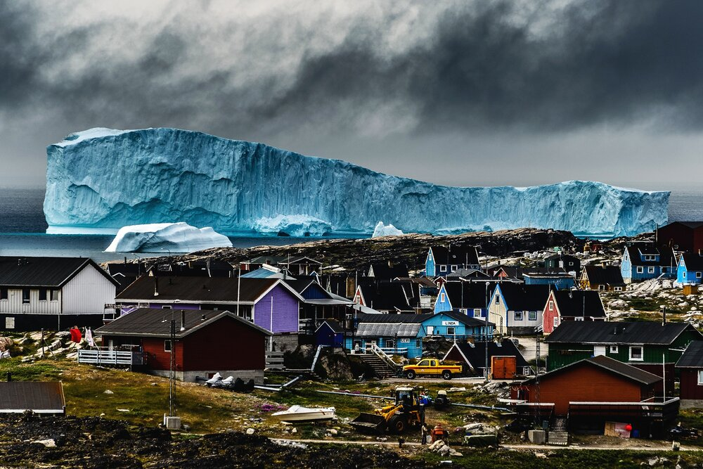 Massive Iceberg Looming Over Qeqertarsuaq, Greenland
