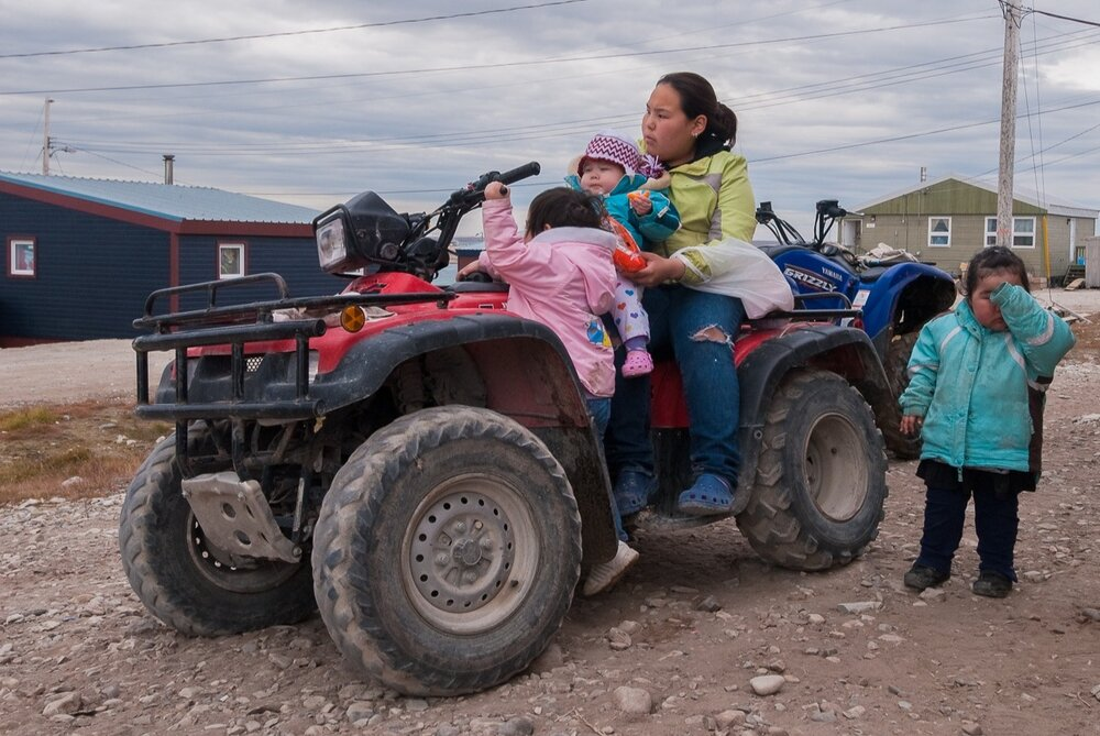 Inuit Mother With Her hands Full - Gjoa Haven, Nunavut, Canadian Arctic