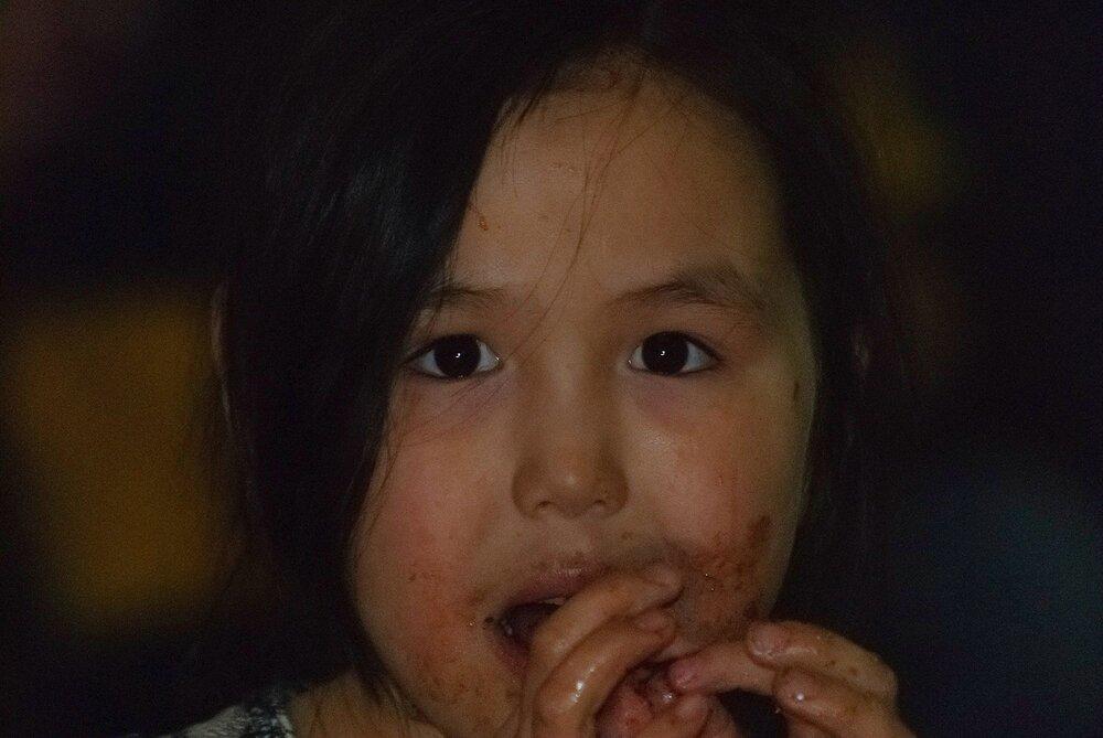 Inuit Girl at Community Feast - Puvirnituq, Nunavik, Canadian Arctic