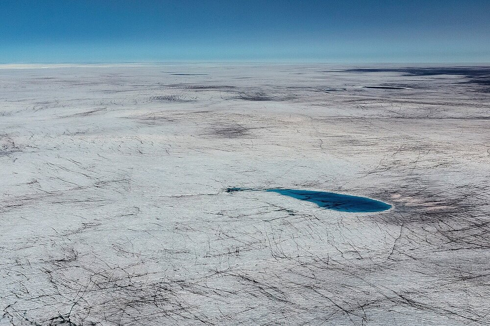 Meltwater Lake and Dark Ice - Greenland Ice Sheet