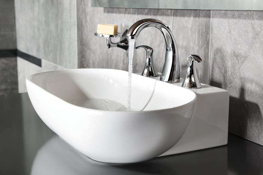 Mezcladora de taladros separados para lavabo YAZ® — Cortesía de URREA