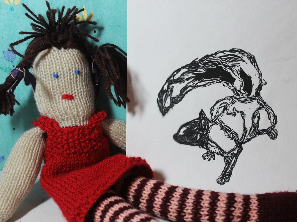Modelled very nicely by knitted Laura, and yes that is my horrible wallpaper.