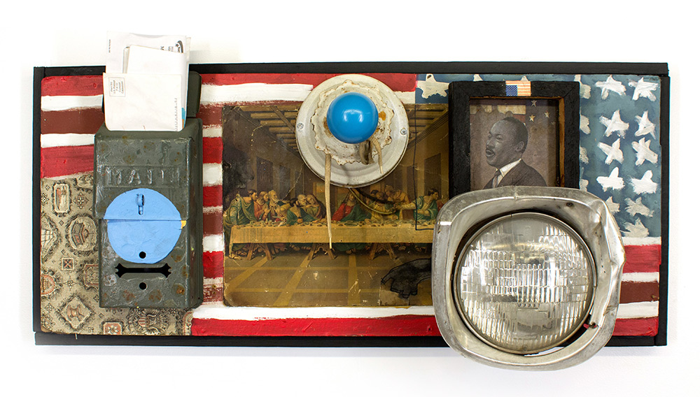 Tyree Guyton Invitation Only - 2003 Mixed Media on Wood Panel, Found Mail Box, Head Light & Light Fixture 16 x 35 x 10 inches  $7,000.00