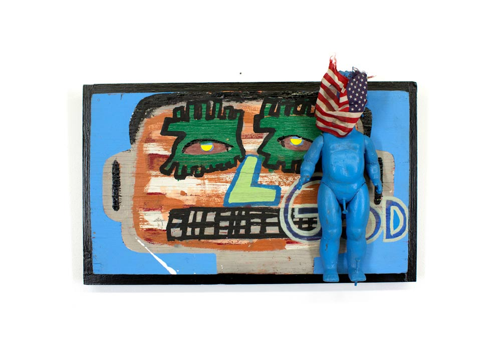 Tyree Guyton 1st Amendment - 2004  Mixed Media on Reclaimed Wood Panel, Doll, Flag, Nails  13 x 20 x 6 inches Mixed Media on Wood $5,000.00
