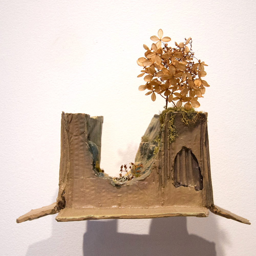 "Valley of Bones   9"" x 10"" x 7""    Cast Resin, Carpet Fiber, Paint, Plant Material   $1,200"