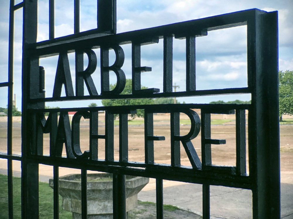 "The infamous slogan  Arbeit Macht Frei  (""work makes you free"")"
