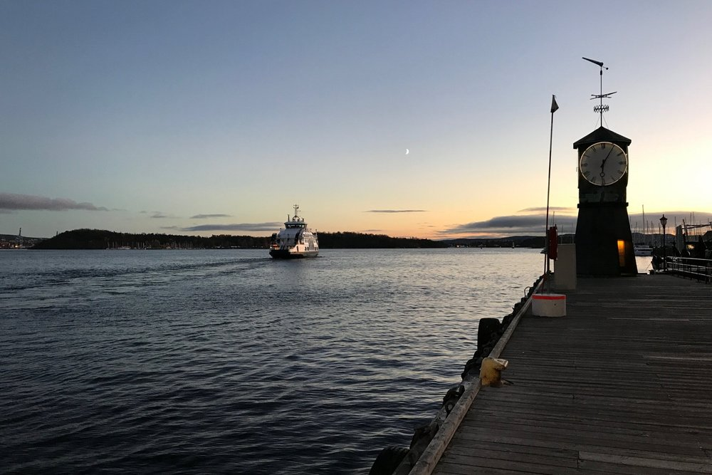 A commuter ferry heads off into the Oslofjord