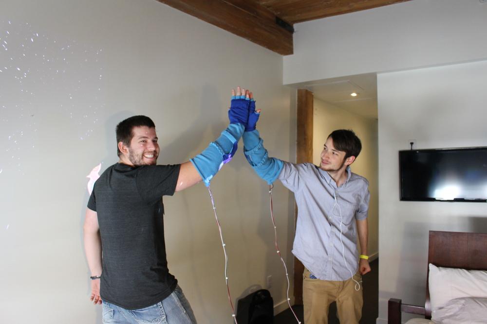 Daniel Rosen and Nick Korneck high five wearing the cotton Hi 5000s