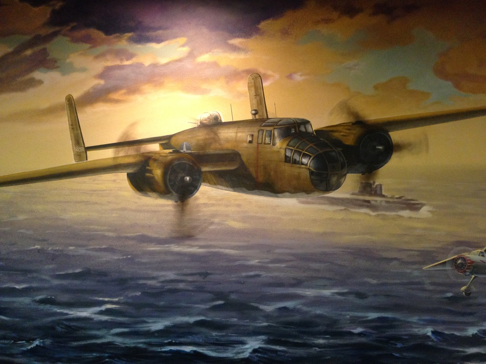 The left side of the mural depicts Doolittle's B-25. In preparation for his famous raid on Tokyo in 1942, the 16 B-25s were flown to Minneapolis for modifications.