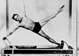 Joseph Pilates does Starfish on the Reformer. A clear utilization of all six limbs!