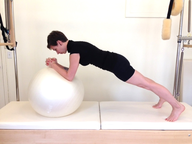 Draw small circles with your elbows keeping your spine totally still. Too hard? Put your knees down!