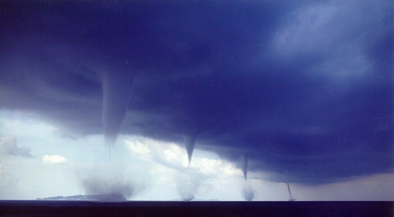 Multiple tornadoes over Albania in 1999. Photographed by Roberto Giudici.