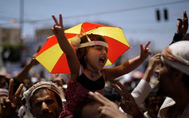 pantslessprogressive: A Yemeni girl is held up by anti-government protestors during a demonstration demanding the resignation of President Saleh in Sana'a, Yemen on April 12, 2011.[Photo:Muhammed Muheisen / AP] Bahrain, Ivory Coast, Jordan, Saudi Arabia, Swaziland, Syria, Yemen News Roundup: April 12 Bahrain: List of people killed in Bahrain since 14th February | Bahrain Center for Human Rights Bahrain opposition figure 'dies in custody' | AJE Daughter of jailed Bahrain human rights activist says she's on hunger strike until his release | AP Bahrain questions 3 reporters, may charge activist | Reuters Bahrain urged to drop charges against editor | AFP Hospital Is Drawn Into Bahrain Strife | NY Times Bahrain Ambassador to the U.S.:CNN Report on Bahrain flawed U.S. Stays Mum as Bahrain Unleashes Brutal Crackdown | ProPublica Human Rights Watch:Suspicious Deaths in Custody Ivory Coast: Gunfire in Abidjan despite Gbagbo arrest | BBC EU urges national unity government in Ivory Coast | Reuters Obama Congratulates Ivory Coast's Ouattara on Assuming Power | Bloomberg UN names Cote d'Ivoire rights probe team | AJE France sees no long military role in Ivory Coast | Reuters Group Sees Ivory Coast Sanctions Lifted Soon | Corruption Currents - WSJ New Leader Consolidates His Control In Ivory Coast | NY Times Search for Lasting Ivorian Peace Begins | AllAfrica Danger stalks streets of tired, angry Abidjan | Reuters Sen. Inofe defends Gbagbo with 'happy face' | TPM Why France must tread carefully in Ivory Coast | BBC Analysis:Ouattara unlikely to salve Ivorian wounds | Reuters Jordan: Jordan tries 81 over March 24 demonstration | AFP Jordan releases 4 jailed members of radical Islamist group in effort to stave off protests | AP Saudi Arabia: Why the United States should push Saudi Arabia toward democracy | PRI/WNYC Swaziland: Swaziland Police Beat, Arrest Protesters | VOA Swazi forces fire at crowds to halt anti-king protest | Reuters Unions' Leadership Arrested | AllAfrica Swazil