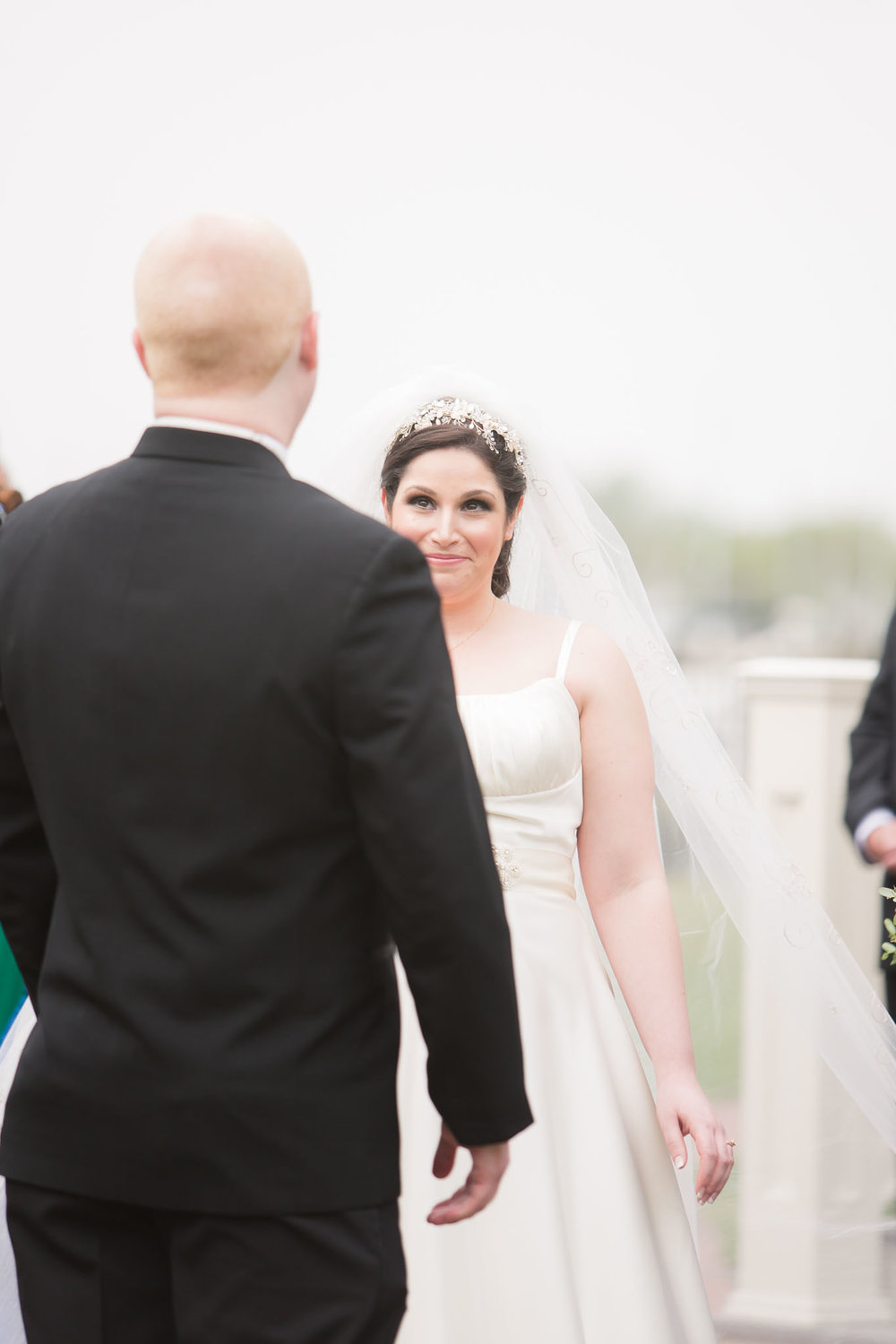 peacock themed wedding at clarks landing first look between bride and groom