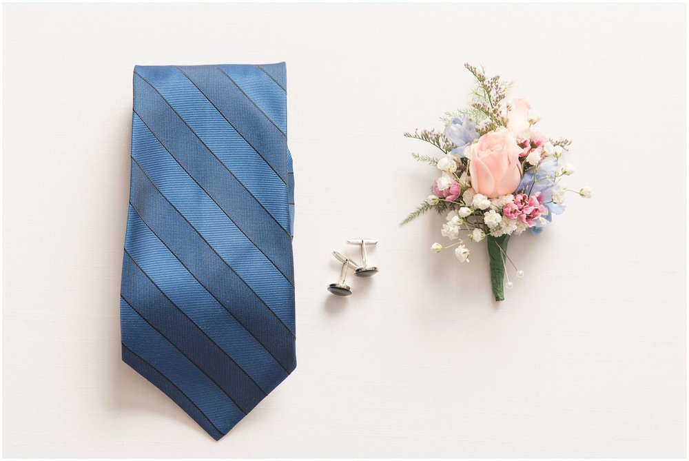 groom details blue striped tie and boutinner