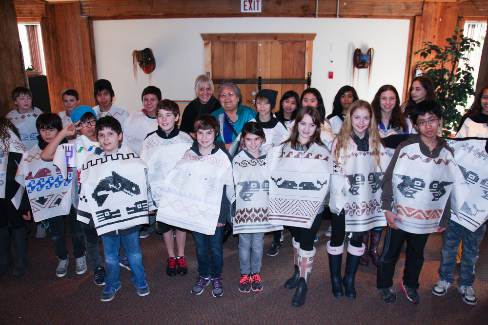 The kids show the Cowichan knitters their designs. Photo: Jennifer Eliuk