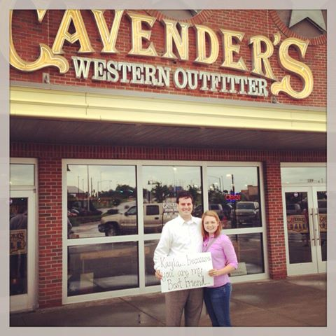 "How we got engaged  ""Brandon had mentioned earlier in the week that our friends Molly and Jacob wanted to go have dinner with us. On Saturday when Brandon got off of work we went up to Legends to meet them .  Brandon said we had to meet Molly and Jake at Cavender's because Molly needed my opinion on some boots.  We started walking over to the store and we are holding hands talking about work.  When we got up to the side of the building, in one of Cavender's windows, there was a sign that said "" Kayla, because you are my best friend...""  I stopped in my tracks trying to process it all. When I turned back to Brandon he was on one knee with tears in his eyes.  I started to cry and of course, hugged him.  About that time Molly, Jake, and Haley ran out of a nearby store! After the initial shock of it all we realized Brandon hadn't actually asked me! Of course my answer was YES!""    Kayla"