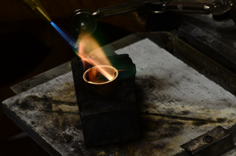 Gold in the crucible, beginning to be formed into a wearable jewel.