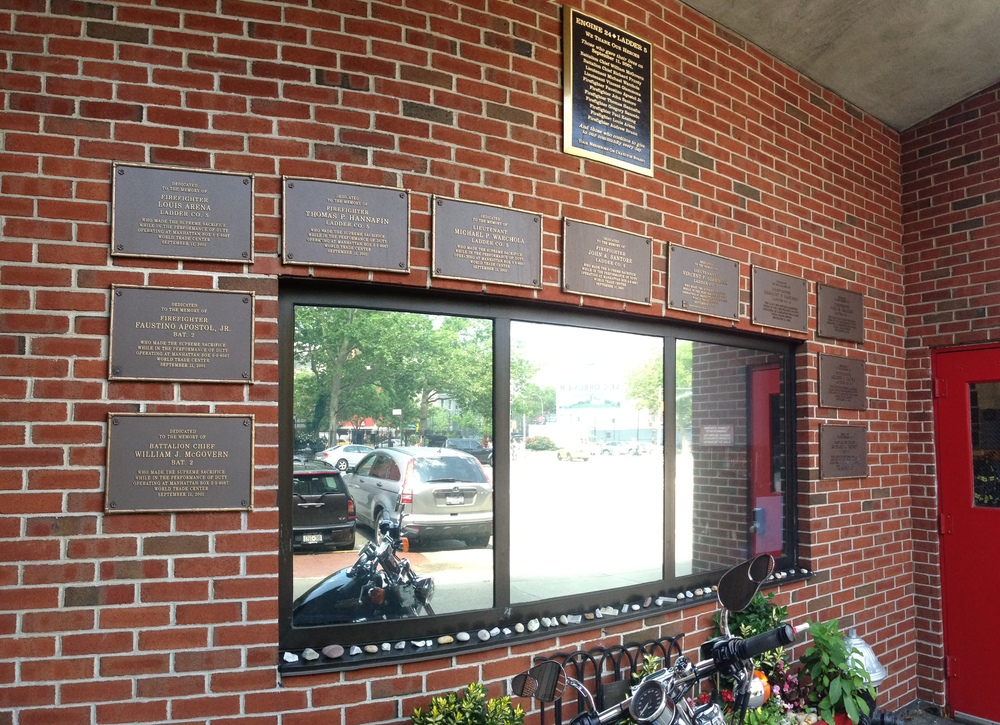 Outside a NYC fire station with plaques of fallen heroes.