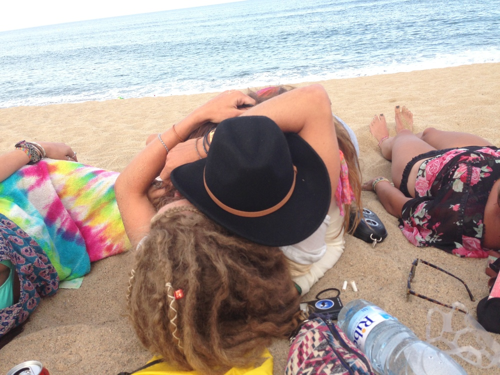 me and scotty embracing on the beach in barcelona :) after a day of busking and a night of sleeping in hammocks in the park.