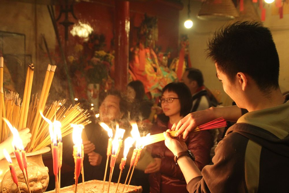Have every fiber of your being perfumed with sandalwood incense at Man Mo Temple.