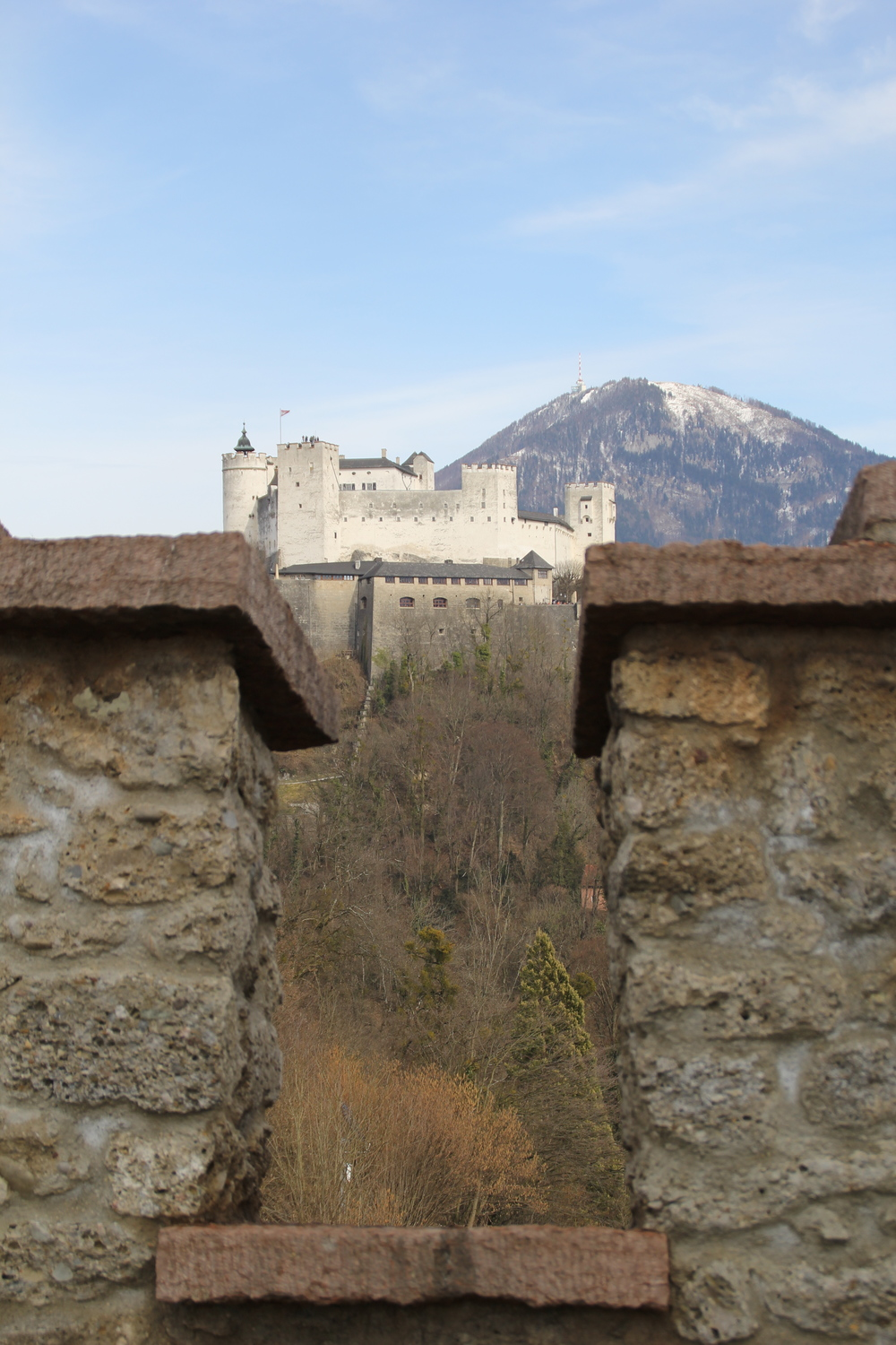 """A view of Festung Hohensalzburg from the city ramparts. Kapuzinerberg is popping up in the background to say """"Hallo!"""""""