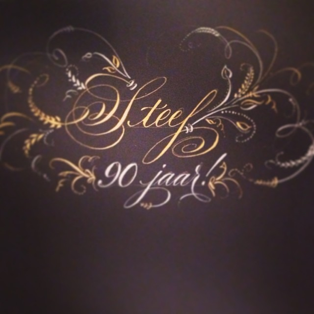 No I don't speak Dutch!  Title page for a 90th birthday photo album and memory book. Silver and gold on black. Wait until dry to erase layout lines!  Oof! (à Studio French Blue )