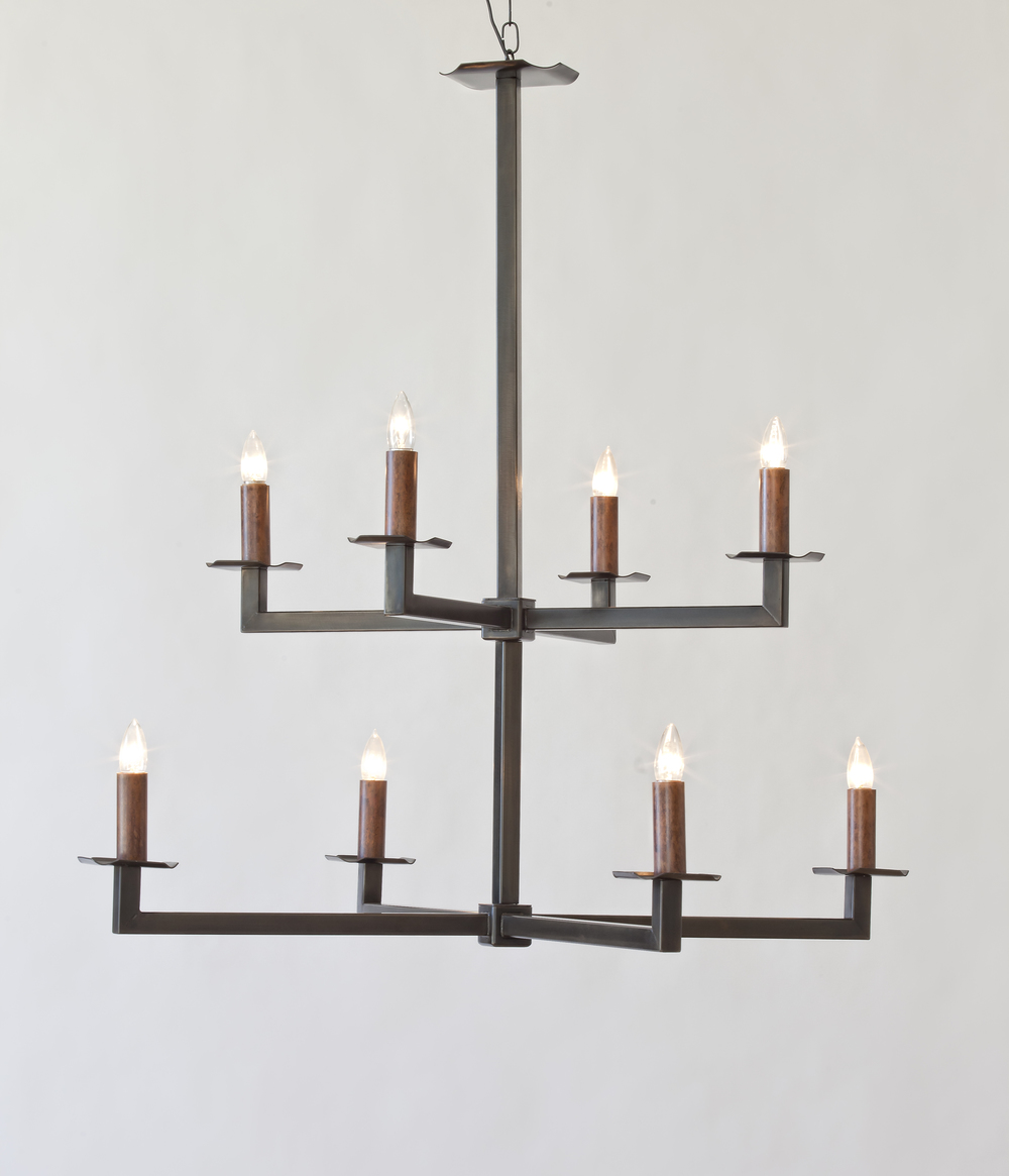 Size: 40 in. high, 40 in. diameter  A contemporary steel chandelier finished in brown patina with dark green undertones. Eight lights; wired for medium base, 40 watts each.