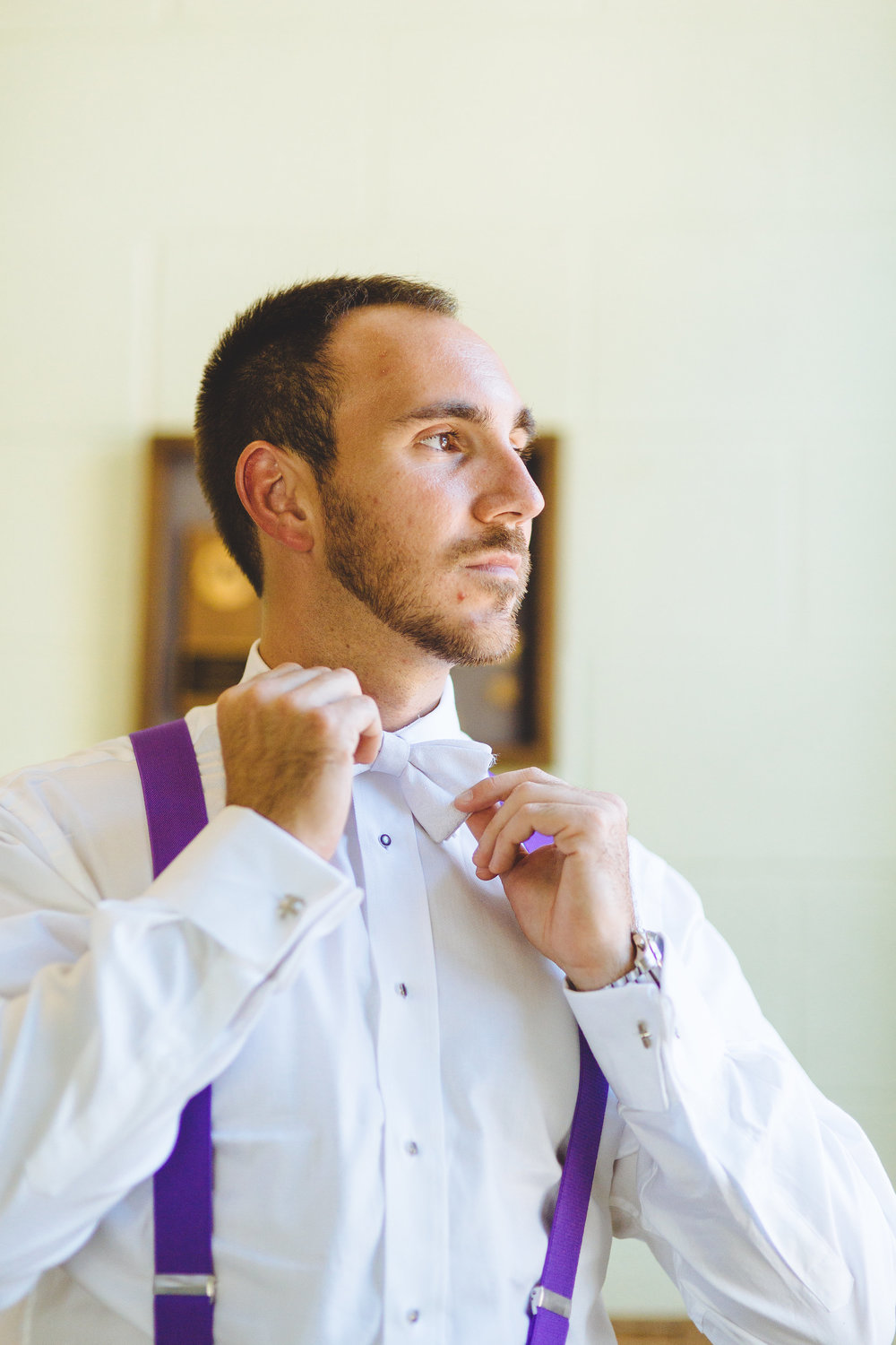 Groom-fixing-bowtie
