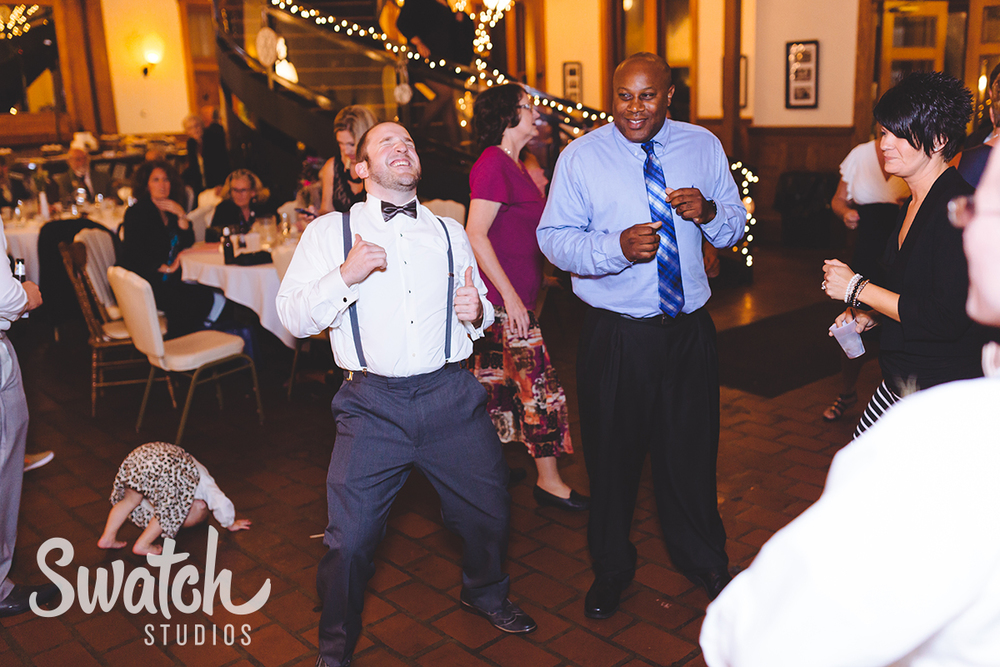 Groom_dances_at_reception