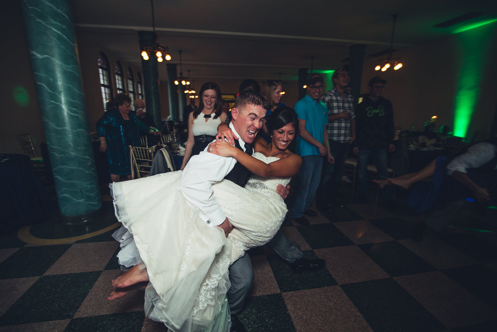 Bride and Groom on Wedding Night Share First Dance at Their Reception with Photographers from Toledo Ohio