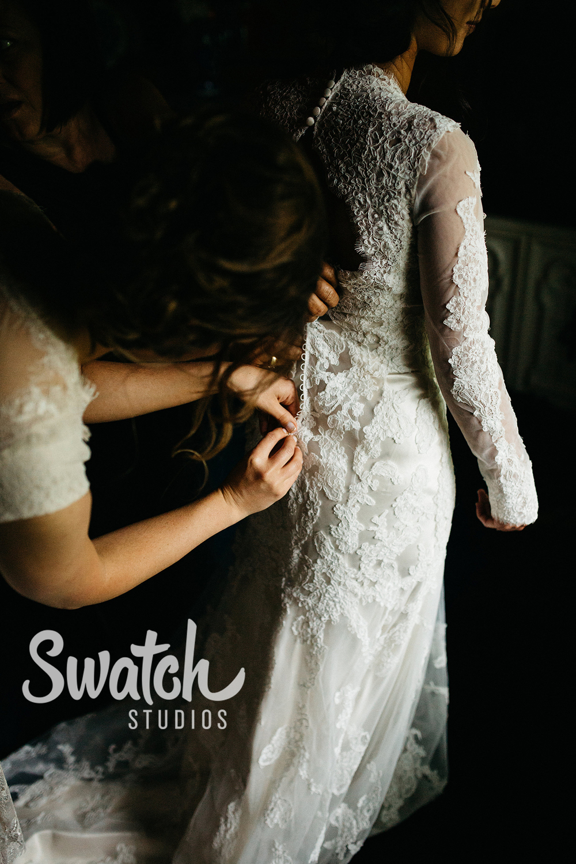 Bride_Putting_On_Wedding_Dress