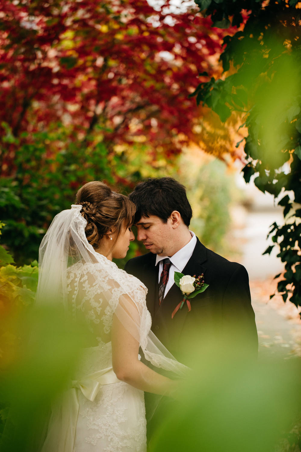 Bride and groom surrounded by beautiful Fall colors