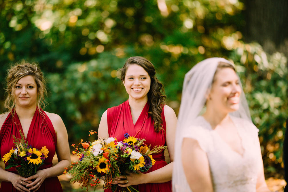 Bridesmaid holds beautiful Fall floral bouquet from Gardenview Flowers
