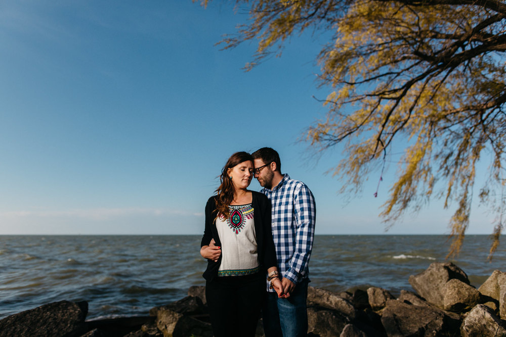 Engagement photos in front of a beautiful view of Lake Erie.