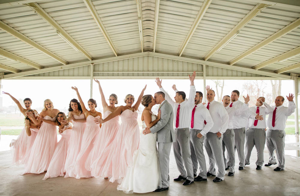 Wedding party celebrate with bride and groom after wedding
