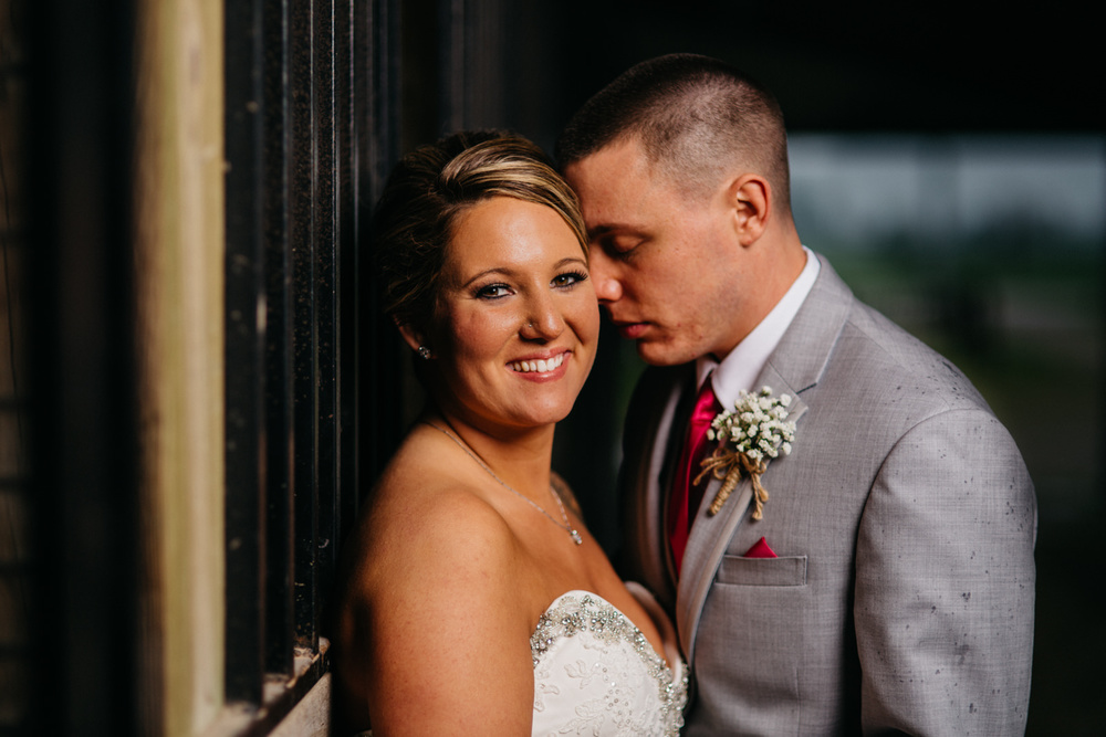 Bride and groom portraits after wedding at Fulton County Fairgrounds