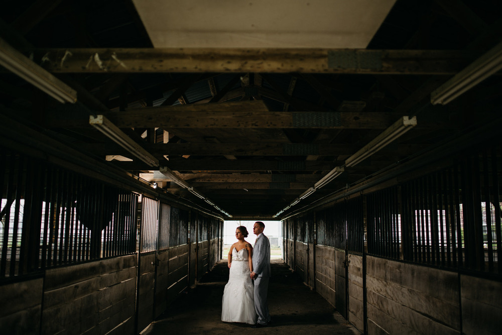 Bride and groom portraits in the stables at fulton county fairgrounds.