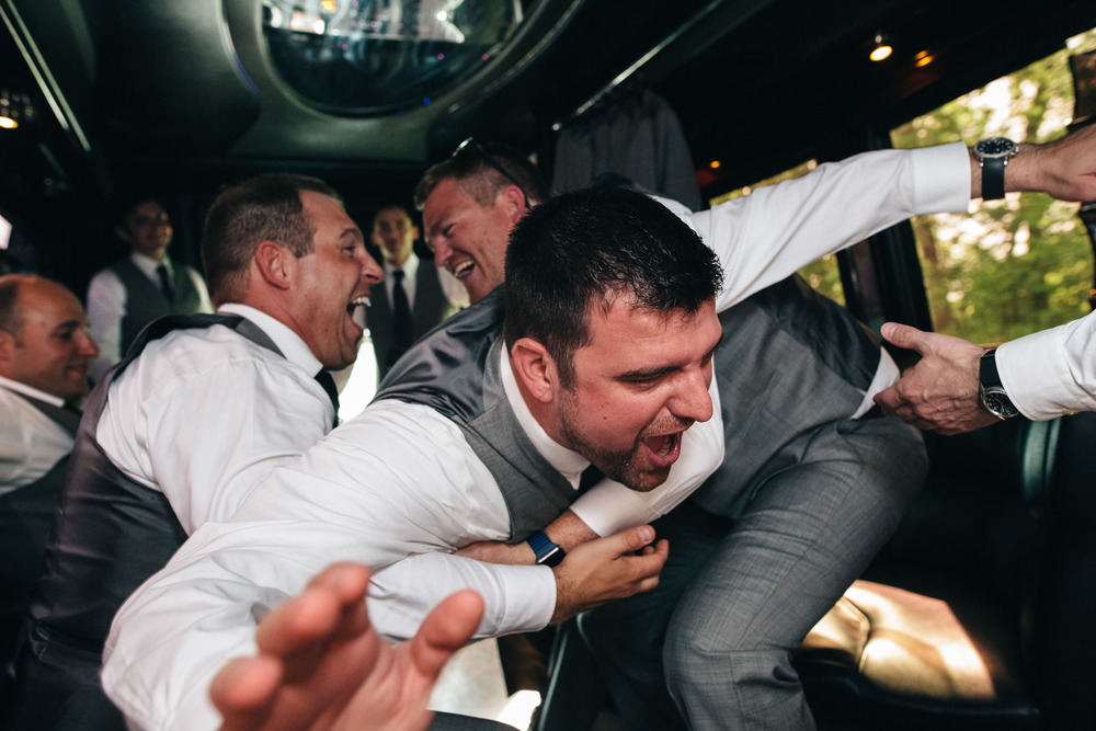 Bridal party having fun on party bus.