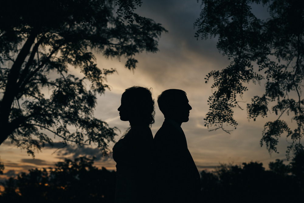 Silhouette at Sunset with bride and groom at Nazareth Hall.