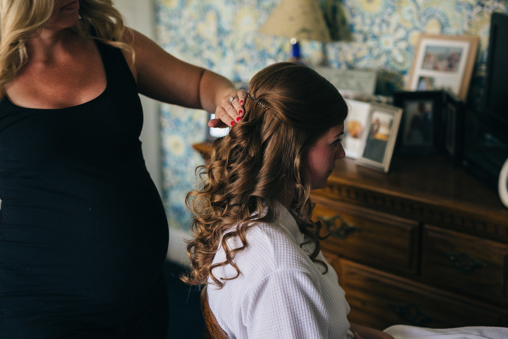 Bride getting hair done before wedding in Wooster, Ohio.