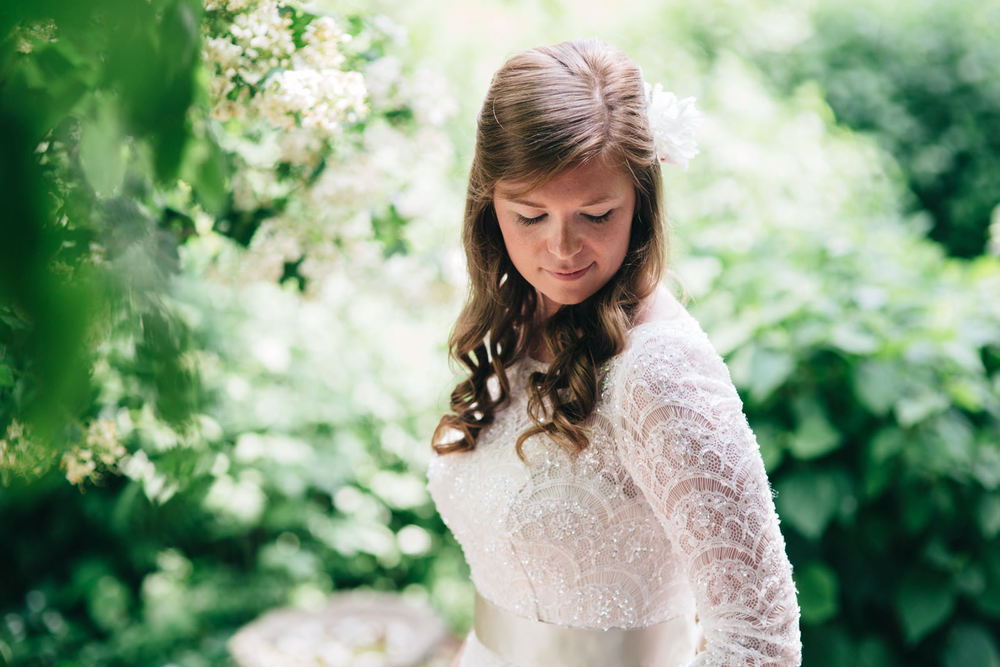 Bridal portrait in beautiful lace dress for summer wedding.