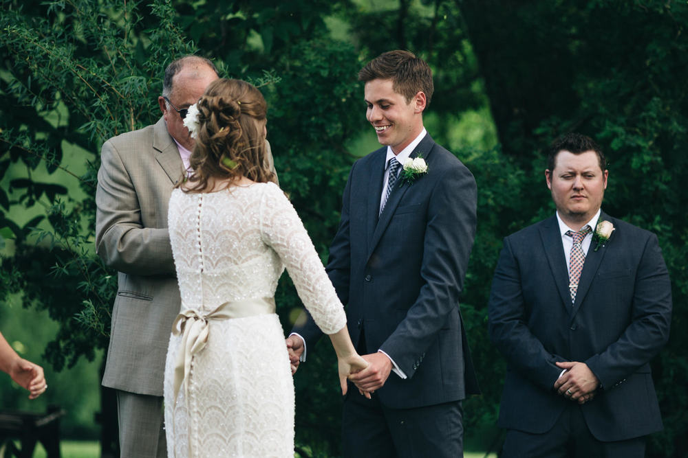 Groom holds brides hand during ceremony at Quailcrest Farm.