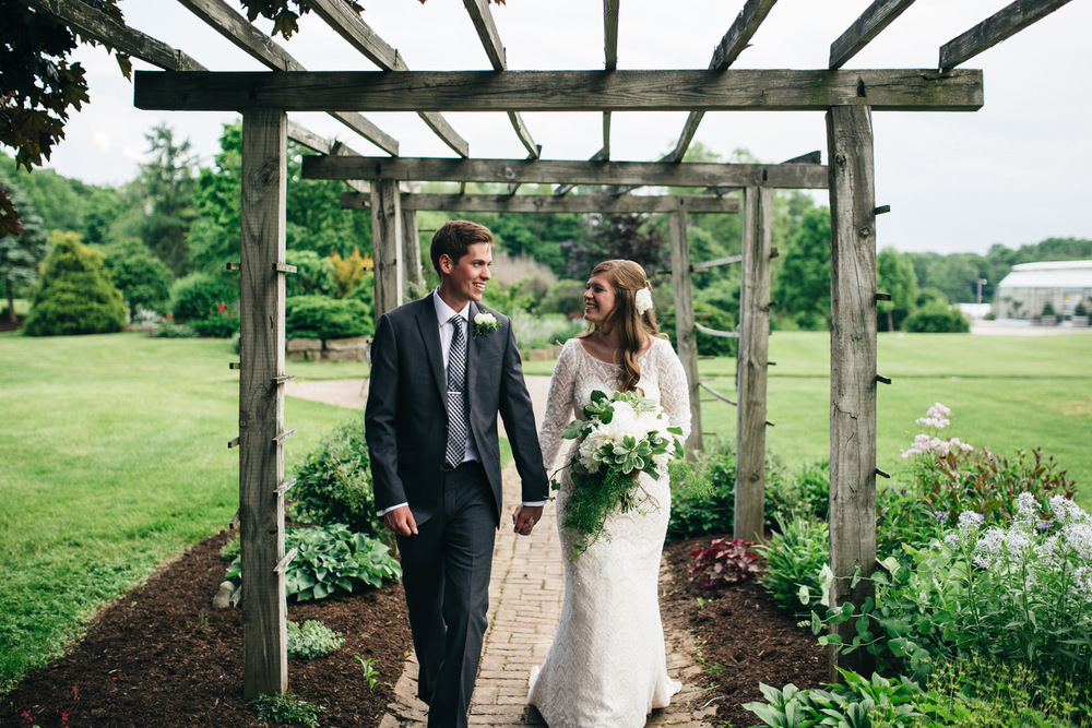 Bride and groom pose in garden at Quailcrest Farm.