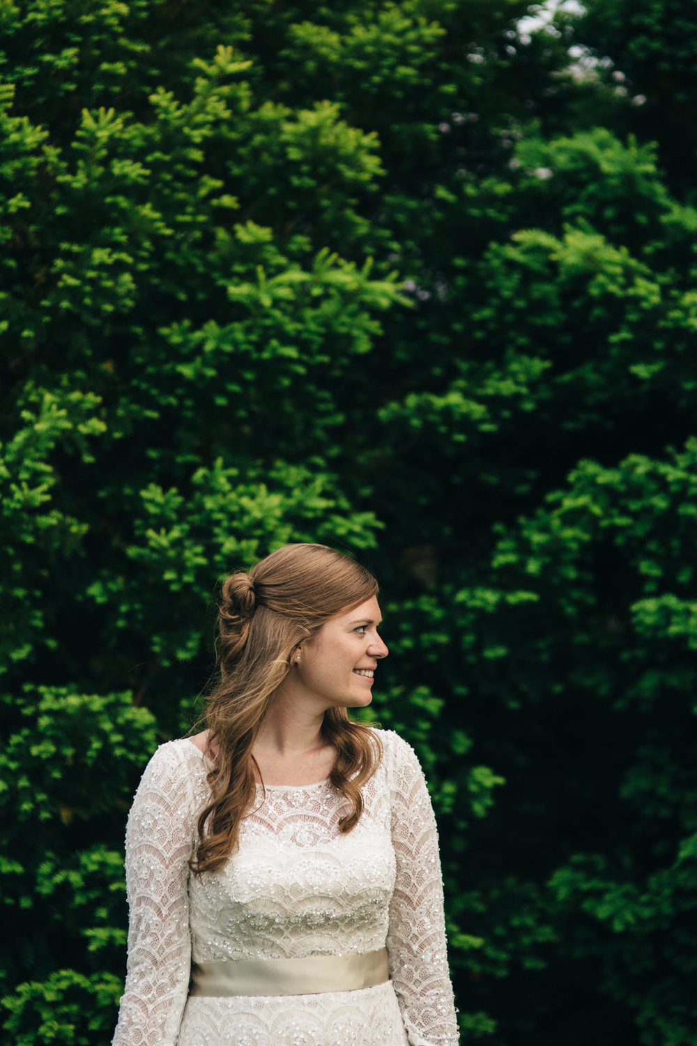 Bride in lace dress during summer wedding in Wooster, Ohio.