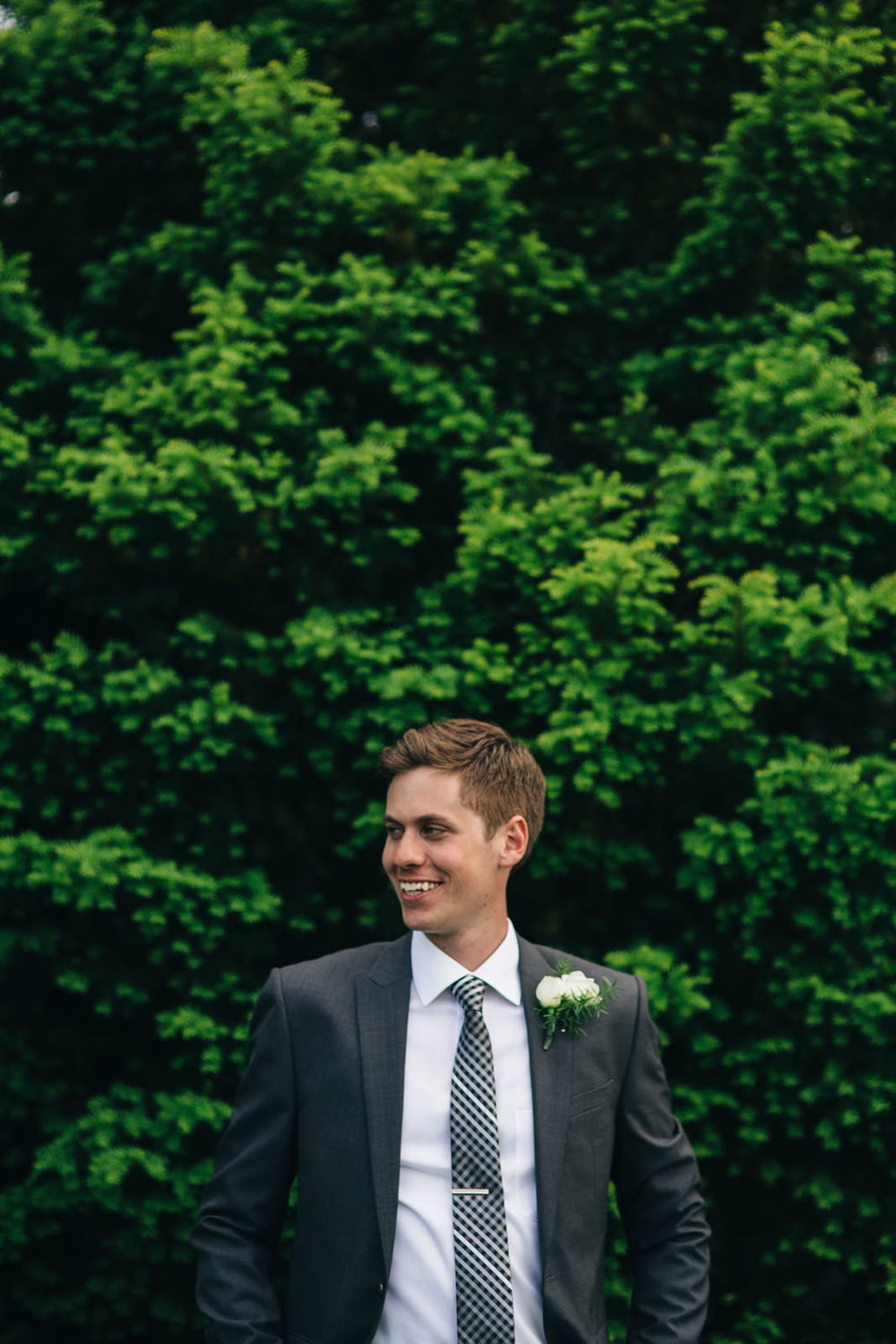 Groom in black suit and checkered tie in Wooster, Ohio Summer wedding.
