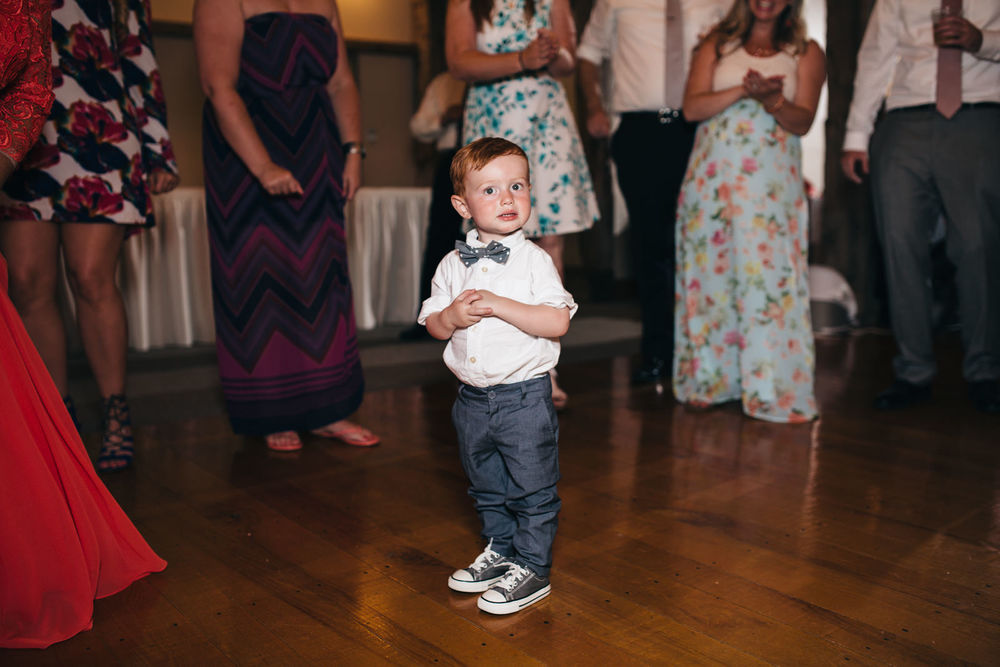 RIng bearer dances at wedding reception in Wooster, Ohio.