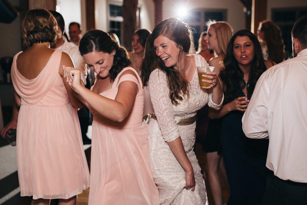 Bride dances with her best friend at wedding reception.